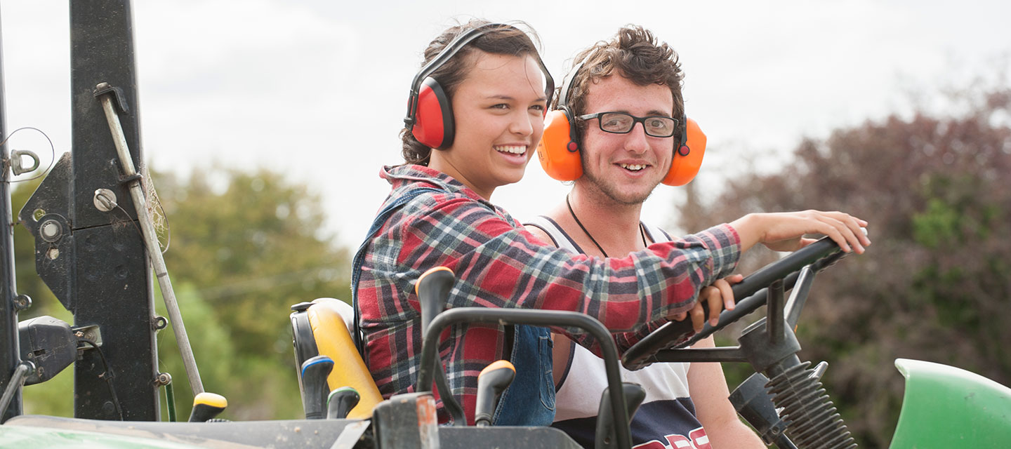 Two young people on a tractor